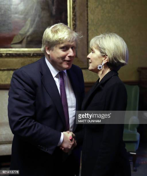 Britain's Foreign Secretary Boris Johnson greets Australian Foreign Minister Julie Bishop ahead of their meeting at the Foreign and Commonwealth...