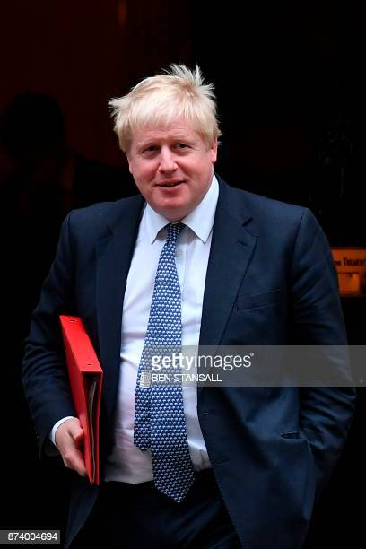 Britain's Foreign Secretary Boris Johnson leaves 10 Downing Street after attending the weekly meeting of the Cabinet in central London on November 14...