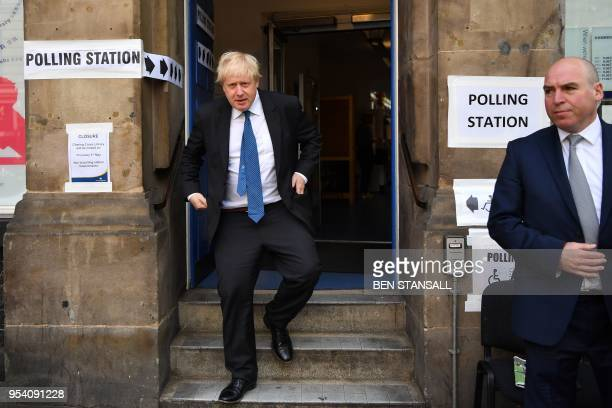 Britain's Foreign Secretary Boris Johnson leaves a polling station after casting his vote in local elections in London on May 3 2018 Voters in...