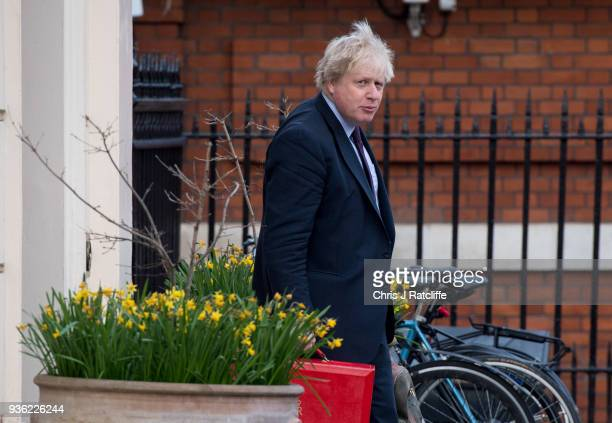 Britain's Foreign Secretary Boris Johnson leaves his home on March 22 2018 in London England Mr Johnson has compared the upcoming Russian football...