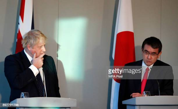 Britain's Foreign Secretary Boris Johnson left listens alongside his Japanese counterpart Foreign Minister Taro Kono during a press conference at the...