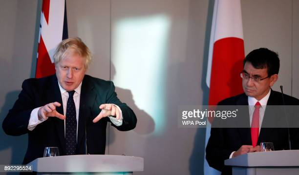 Britain's Foreign Secretary Boris Johnson left speaks alongside his Japanese counterpart Foreign Minister Taro Kono during a press conference at the...