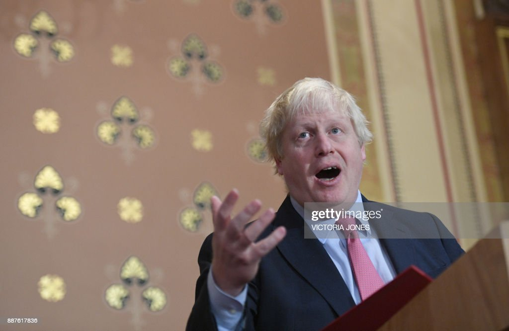 Britain's Foreign Secretary Boris Johnson presents a speech on Islamist terrorism to an audience of academics, diplomats and members of the media at the Foreign Office in London on December 7, 2017. / AFP PHOTO / POOL / Victoria Jones
