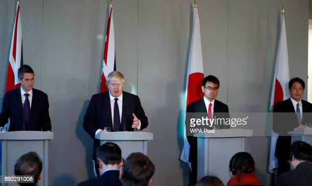 Britain's Foreign Secretary Boris Johnson second left speaks alongside Defence Secretary Gavin Williamson left and their Japanese counterparts...