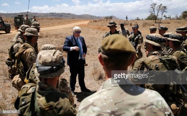 Britain's Foreign Secretary Boris Johnson talks to British soldiers at the British Training Unit Kenya popularly known as BATUK in Ole Naishu near...