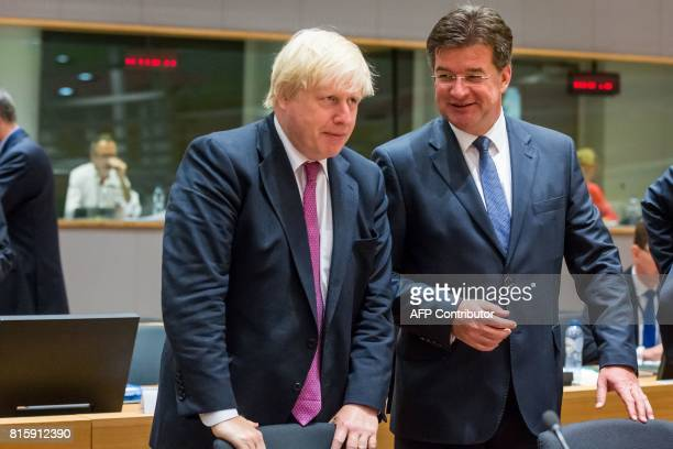 Britain's Foreign Secretary Boris Johnson talks to Ukrainian former Foreign Minister Leonid Kozhara at the European Council for the Foreign Affairs...