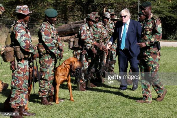 Britain's Foreign Secretary Boris Johnson talks to wildlife rangers at the Joint Operation Command Centre at the Lewa Wildlife Conservancy in...