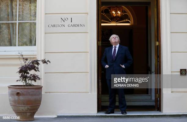 Britain's Foreign Secretary Boris Johnson waits to greet US secretary of state Rex Tillerson , outside Carlton Gardens in London, on May 26 ahead of...