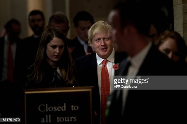 Britain's Foreign Secretary Boris Johnson walks to a meeting with Senate Majority Leader Senator Mitch McConnell on Capitol Hill November 8 2017 in...