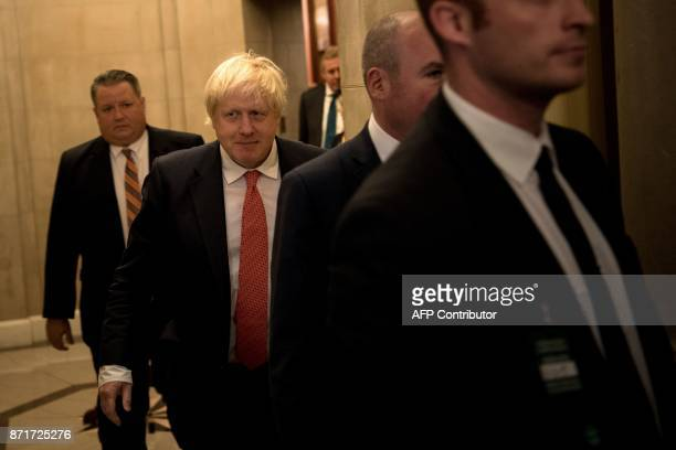 Britain's Foreign Secretary Boris Johnson walks to meetings with US lawmakers on Capitol Hill November 8 2017 in Washington DC / AFP PHOTO / Brendan...