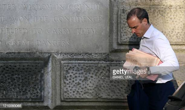 Britain's Foreign Secretary Dominic Raab arrives at the rear of the walks Foreign Office in central London on April 16 2020 The British government...