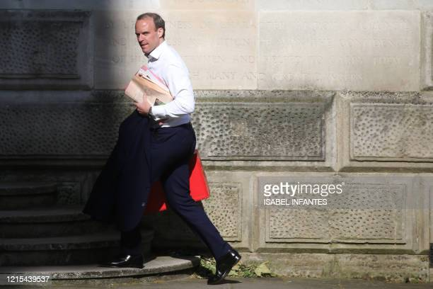 Britain's Foreign Secretary Dominic Raab arrives in Downing street for the daily Covid-19 briefing in central London on May 27, 2020. - British Prime...
