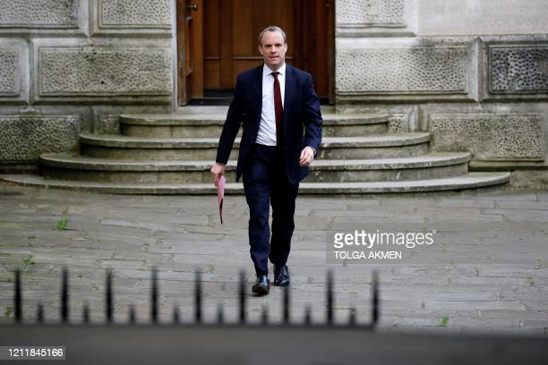 Britain's Foreign Secretary Dominic Raab arrives in Downing Street in central London on May 5 2020 for the daily novel coronavirus COVID19 briefing...