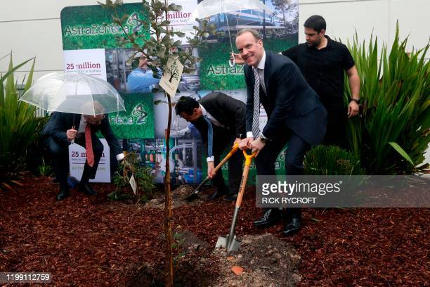 Britain's Foreign Secretary Dominic Raab participates in a tree planting ceremony at British-Swedish multinational biopharmaceutical company,...