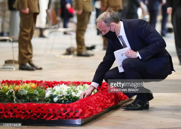 Britain's Foreign Secretary Dominic Raab places a floral tribute by the British grave of the Unknown Warrior during a service of commemoration and...