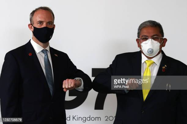 Britain's Foreign Secretary Dominic Raab poses with Brunei Second Minister of Foreign affairs Erywan Yusof during a bilateral meeting at the G7...