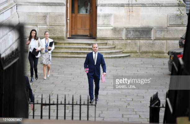 Britain's Foreign Secretary Dominic Raab walks from the Foreign Office towards 10 Downing Street in central London to attend the Government's daily...