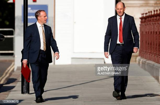 Britain's Foreign Secretary Dominic Raab walks with new Permanent Under Secretary Philip Barton as they arrive at the new Foreign, Commonwealth and...