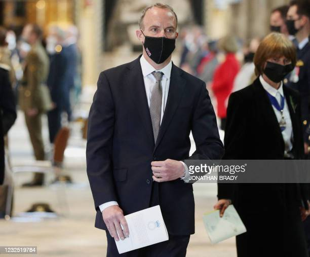 Britain's Foreign Secretary Dominic Raab wearing a face covering leaves after attending a service of commemoration and thanksgiving to mark Anzac Day...