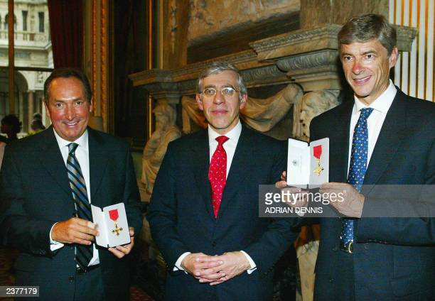 Britain's Foreign Secretary Jack Straw poses after presenting football managers Arsene Wenger of Arsenal and Gerard Houllier of Liverpool with an OBE...