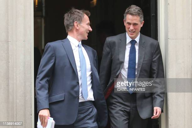 Britain's Foreign Secretary Jeremy Hunt and Britain's Defence Secretary Gavin Williamson leave 10 Downing Street after attending a Cabinet meeting in...