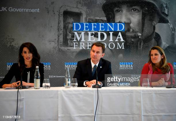 Britain's Foreign Secretary Jeremy Hunt and Canada's Foreign Minister Chrystia Freeland attend a press briefing by LebaneseBritish humanrights lawyer...