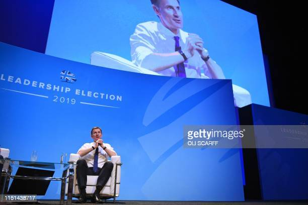 Britain's Foreign Secretary Jeremy Hunt answers questions from journalist Iain Dale and the audience as he takes part in a Conservative Party...