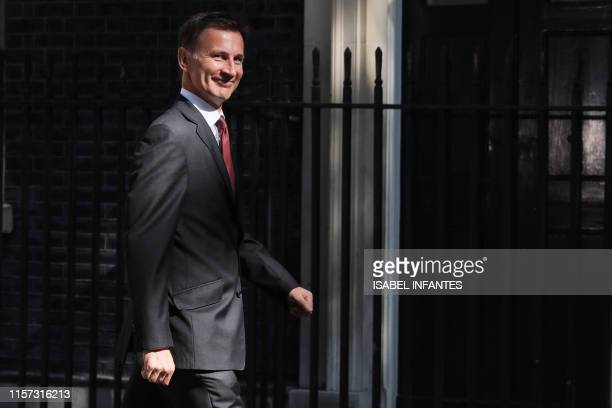 Britain's Foreign Secretary Jeremy Hunt arrives to attend the weekly meeting of the cabinet at 10 Downing Street in central London on July 23, 2019....
