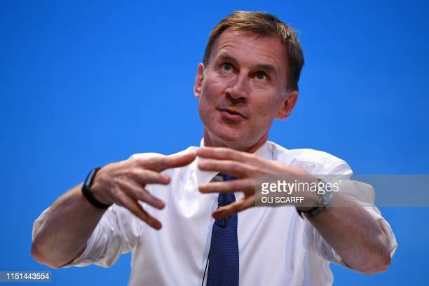 Britain's Foreign Secretary Jeremy Hunt gestures as he answers questions from journalist Iain Dale and the audience as he takes part in a...