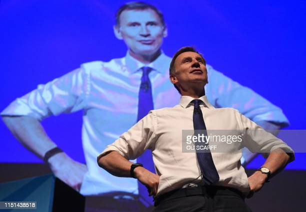 Britain's Foreign Secretary Jeremy Hunt gestures as he speaks to the audience as he takes part in a Conservative Party leadership hustings event in...