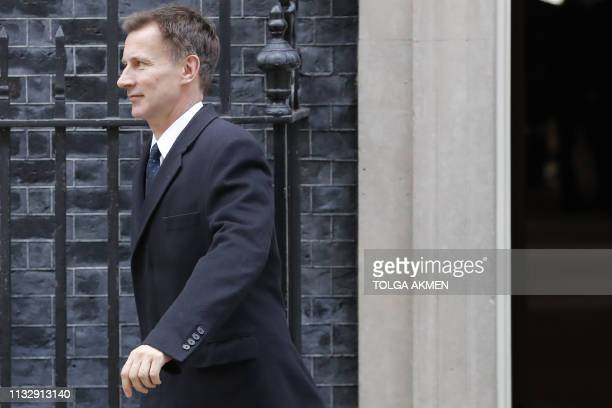 Britain's Foreign Secretary Jeremy Hunt leaves 10 Downing street London after a cabinet meeting on March 26 2019 Britain's parliament began plotting...