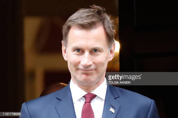 Britain's Foreign Secretary Jeremy Hunt leaves 10 Downing street in central London after attending the weekly cabinet meeting on June 25 2019