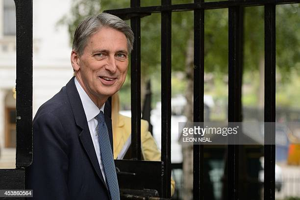Britain's Foreign Secretary Philip Hammond arrives in Downing Street central London on August 20 ahead of a meeting to discuss the ongoing crisis...