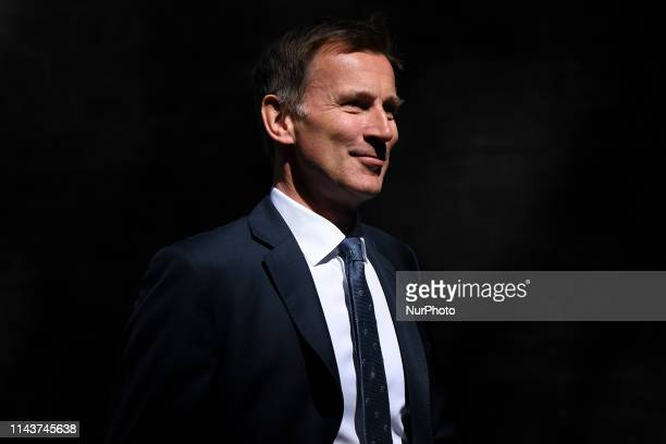 Britain's Foreign Secretary Secretary Jeremy Hunt leaves after attending the weekly meeting of the Cabinet at 10 Downing Street in central London on...
