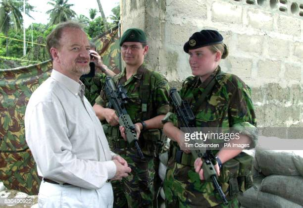 Britain's Foriegn Secretary Robin Cook meets Wren Operator Mechanic Faye Turney from Shropshire and Marine Darren Notman from Plymouth of 42 Royal...