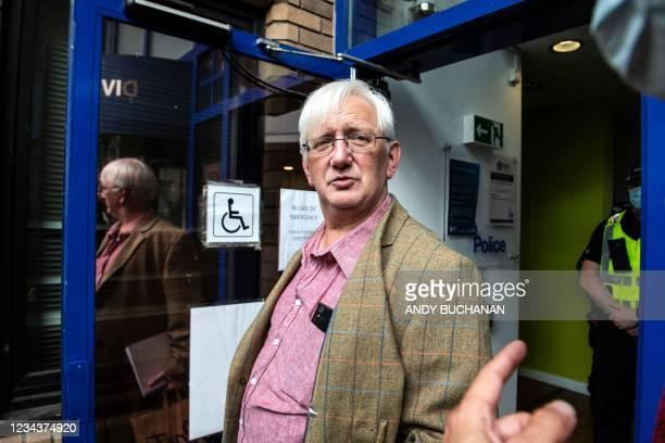 Britain's former ambassador to Uzbekistan, Craig Murray arrives at St Leonard's Police Station in Edinburgh on August 1, 2021 to begin his sentence...