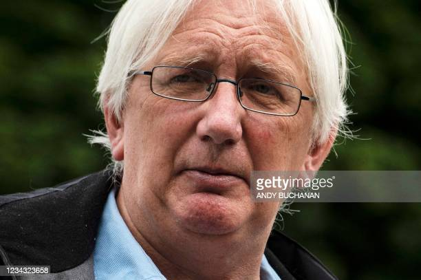 Britain's former ambassador to Uzbekistan, Craig Murray, speaks to supporters outside the Scottish Parliament in Edinburgh on July 30, 2021 after the...