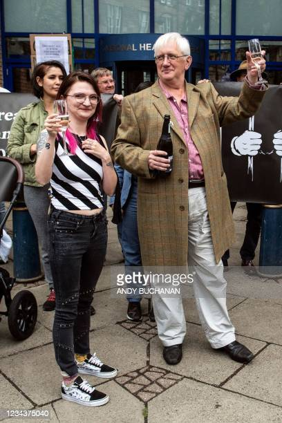 Britain's former ambassador to Uzbekistan, Craig Murray spends final moments with members of his family, raising a glass with daughter Emily Murray...