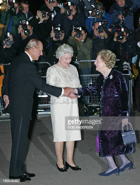 Britain's former Prime minister Lady Margaret Thatcher greets her Majesty Queen Elizabeth II and Prince Philip arriving for Thatcher's 80th birthday...