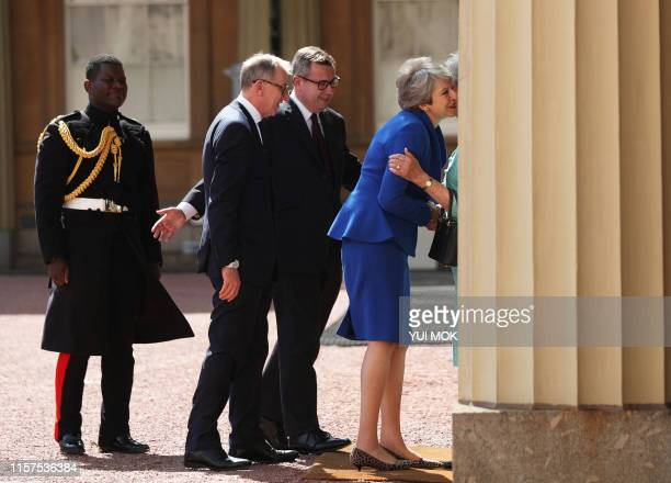 Britain's former Prime Minister Theresa May and her husband Philip are greeted are greeted by Major Nana TwumasiAnkrah Household Cavalry Regiment and...