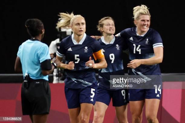 Britain's forward Ellen White celebrates scoring her team's second goal with Britain's defender Steph Houghton and Britain's defender Millie Bright...