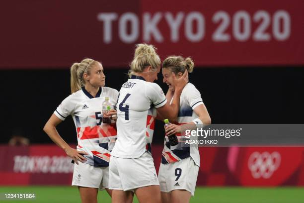 Britain's forward Ellen White celebrates with teammates after Britain won the Tokyo 2020 Olympic Games women's group E first round football match...