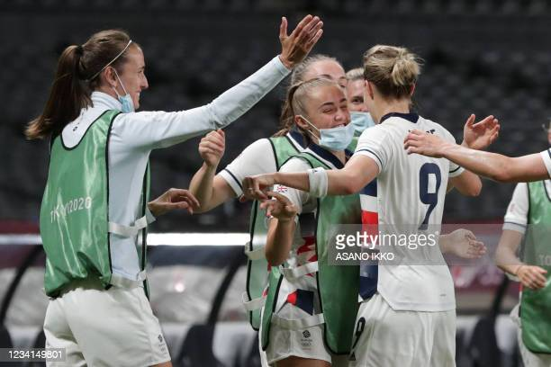 Britain's forward Ellen White celebrates with teammates after scoring a goal during the Tokyo 2020 Olympic Games women's group E first round football...