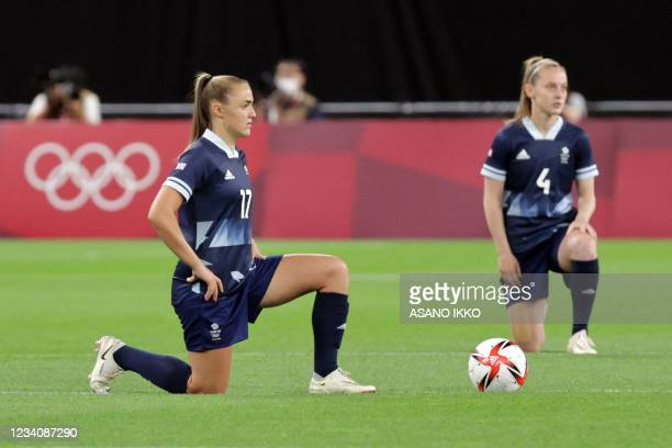 Britain's forward Georgia Stanway and Britain's midfielder Keira Walsh take a knee before the Tokyo 2020 Olympic Games women's group E first round...