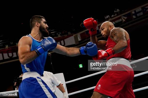 Britain's Frazer Clarke and France's Mourad Aliev fight during their men's super heavy quarter-final boxing match during the Tokyo 2020 Olympic Games...