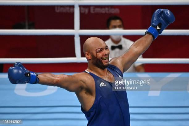 Britain's Frazer Clarke reacts as he fights Uzbekistan's Bakhodir Jalolov during their men's super heavy semi-final boxing match during the Tokyo...