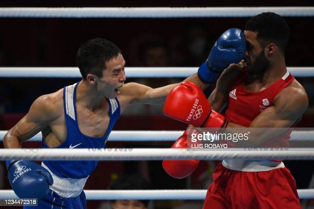 Britain's Galal Yafai and Kazakhstan's Saken Bibossinov fight during their men's fly semi-final boxing match during the Tokyo 2020 Olympic Games at...