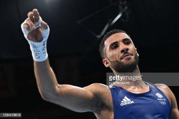 Britain's Galal Yafai celebrates after winning against Cuba's Yosbany Veitia after their men's fly quarter-final boxing match during the Tokyo 2020...