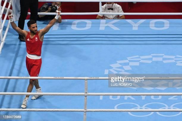 Britain's Galal Yafai celebrates after winning against Kazakhstan's Saken Bibossinov after their men's fly semi-final boxing match during the Tokyo...