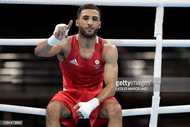 Britain's Galal Yafai celebrates after winning against Kazakhstan's Saken Bibossinov after during their men's fly semi-final boxing match during the...